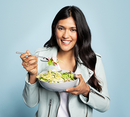 Woman eating salad, Get Ready to Treat Yourself Spend $10, Get $10 Eateries on Level 4 Wednesdays in March The Shops at North Bridge Michigan Avenue