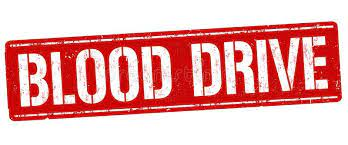 Sign stating blood drive with red background and white lettering