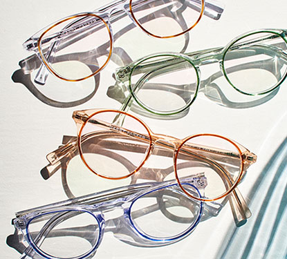 4 pairs of colorful Warby Parker glasses