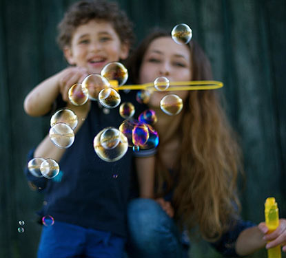 Mother and son blowing bubbles