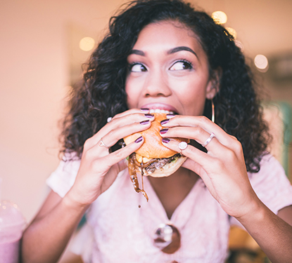 Young woman eating a burger