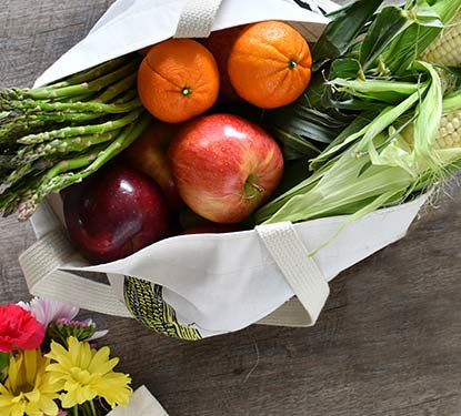 Tote filled with fruits and vegetables