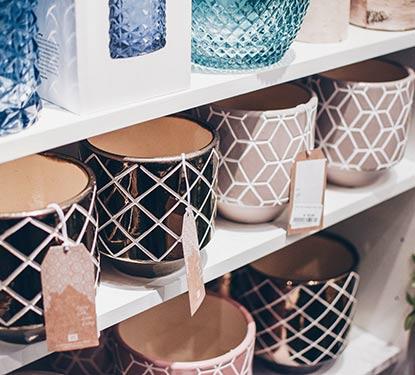 Pottery for sale on a shelf