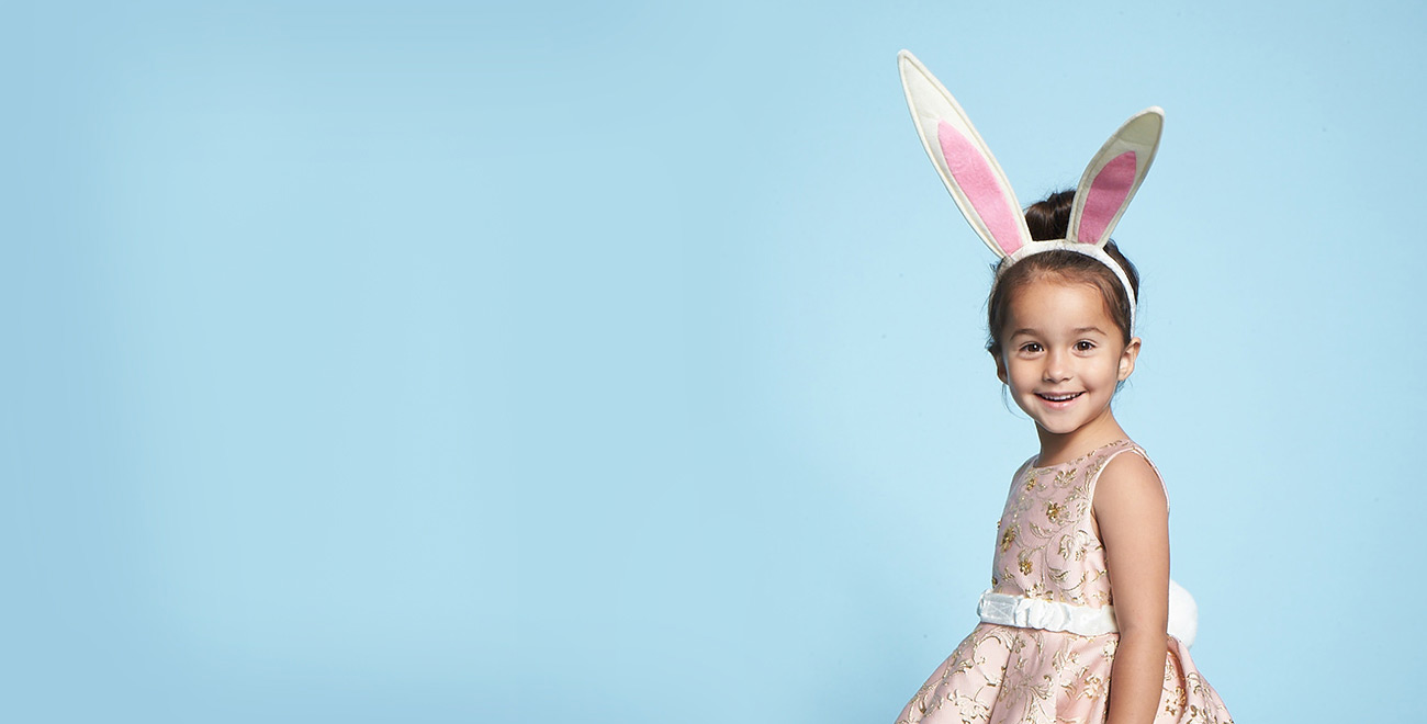 Image of young girl in Easter dress and bunny ears