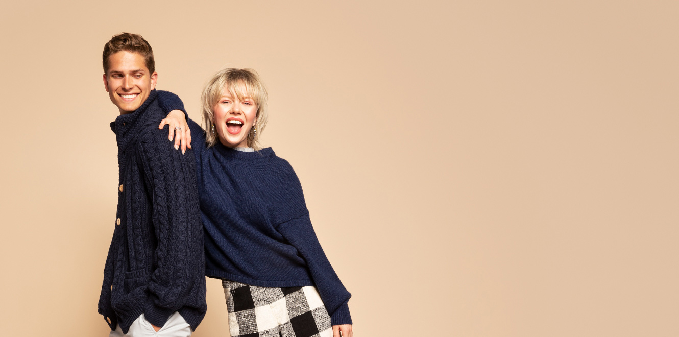 Happy young couple wearing blue fall sweaters