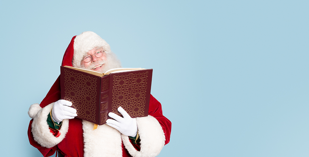 Santa reading a fancy book