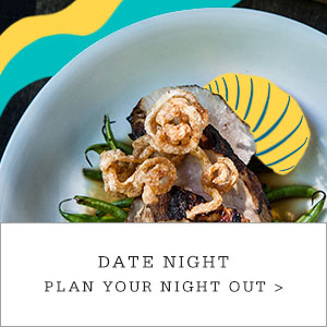 "A plate of calamari and oysters with cartoon graphics applied to the image. Copy reads ""Date Night. Plan Your Night Out."""