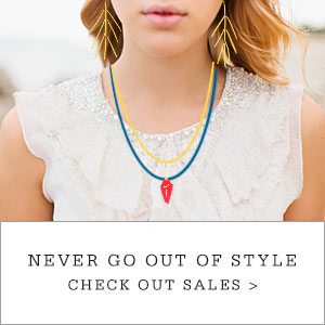 "Girl with earrings and necklace drawn on in pop art style. Copy reads ""Never Go Out Of Style. Check Out Sales."""