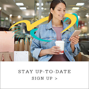 "Woman holding coffee and cell phone, with pop art graphics applied to image. Copy reads ""Stay Up-To-Date. Sign Up."""