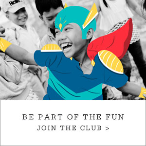 "Young boy in a cartoon superhero costume. Copy reads ""Kids Club. Be Part of the Fun. Join the Club."""