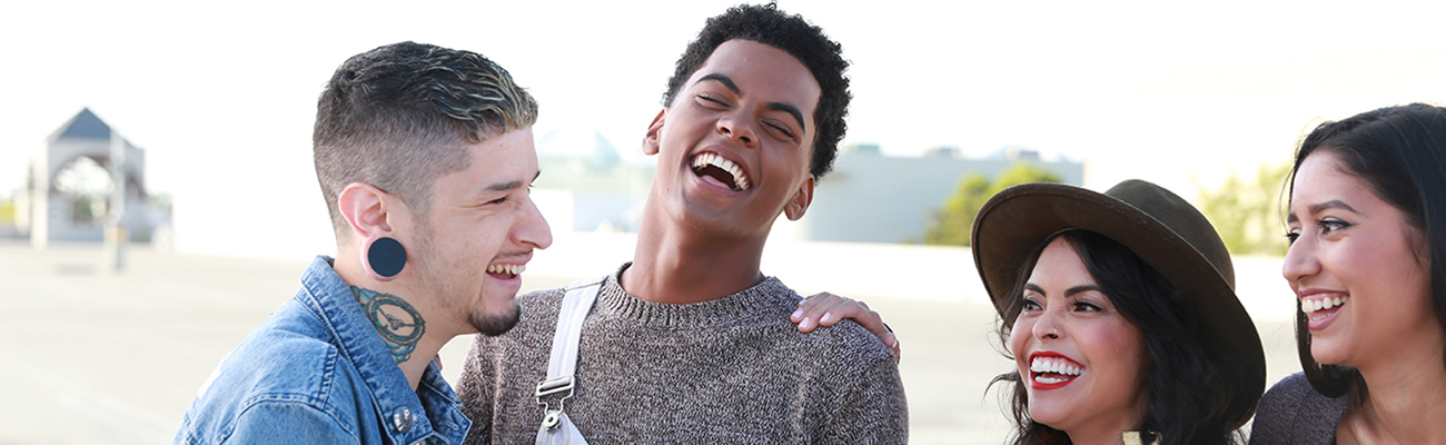Group of hip young people laughing together