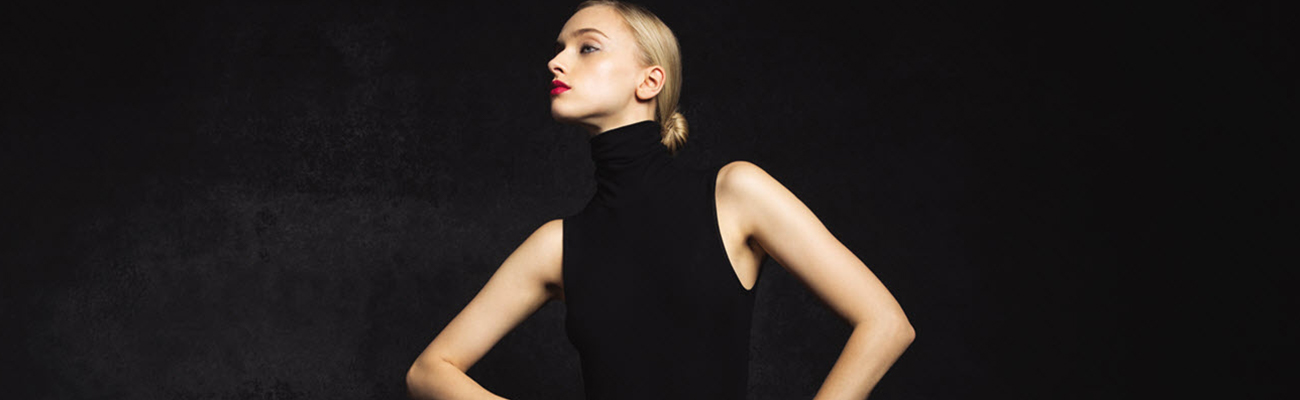 Image of a model wearing a high-collared black dress