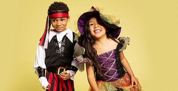 Boy and girl in Halloween Costumes.