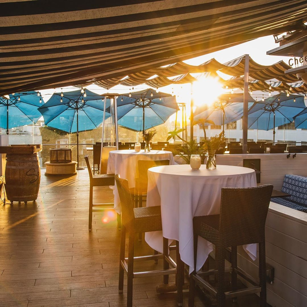 Rooftop dining at sunset