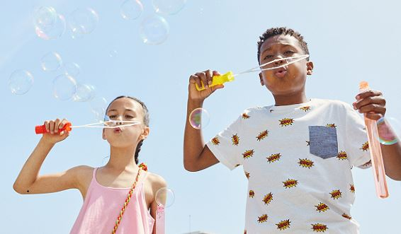2 children blowing bubbles