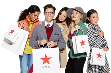 Image of men and women with Macy's shopping bags