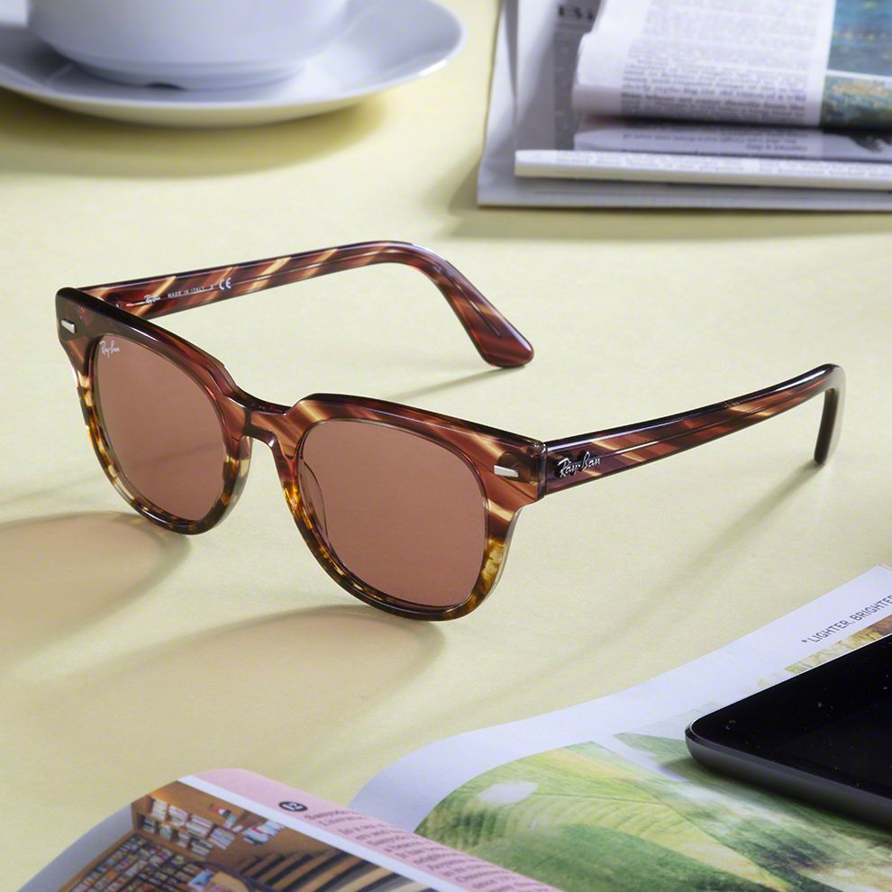 Pair of sunglasses sitting on a table.