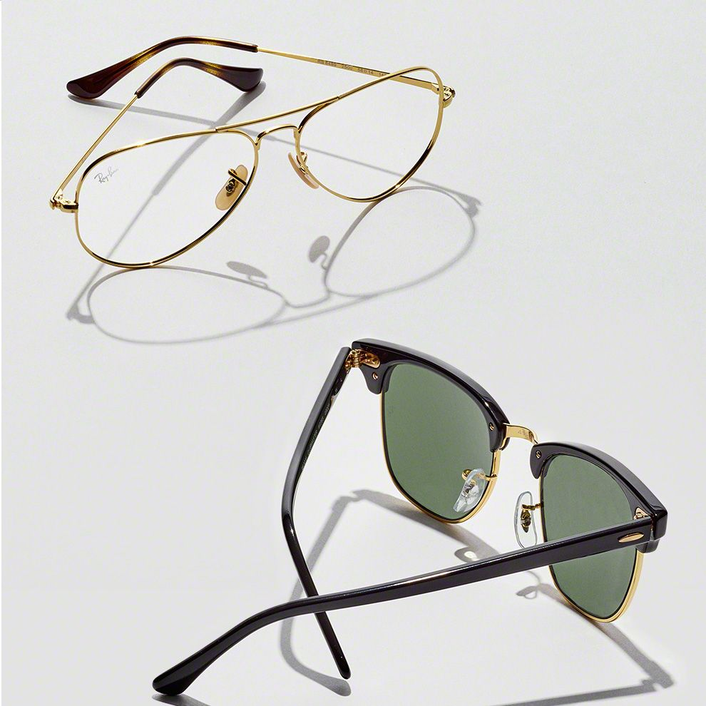Two pairs of glasses. First is prescription glasses in metal frame. Second is prescription sunglasses in black and gold frame.