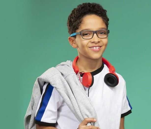 Young boy wearing blue/gray eyeglass frames