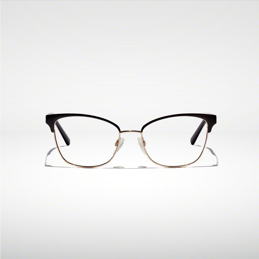 Single pair or prescription eyeglasses with black from on upper portion sitting on a table